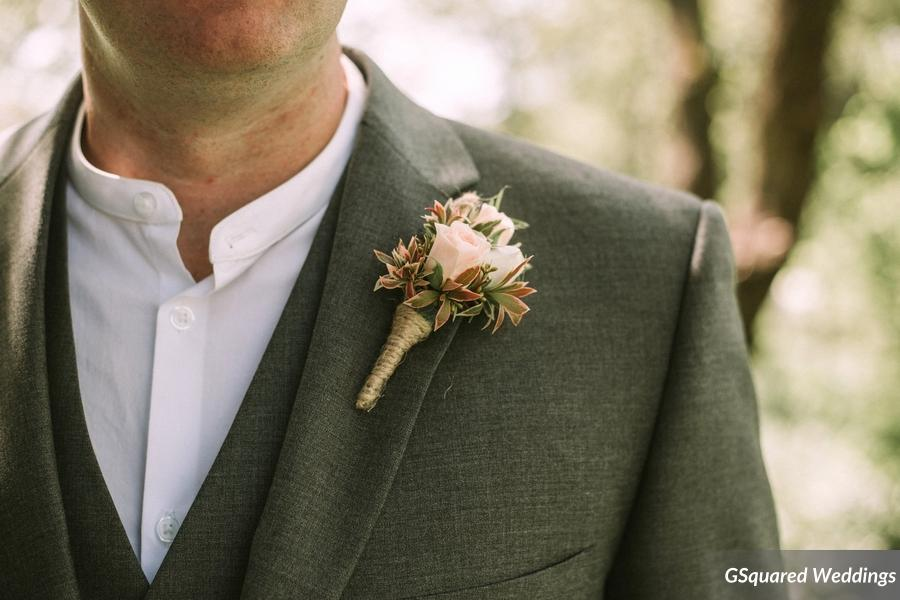 A Well Styled Groom Stands Up With His Bride