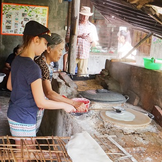 Claire learns how to spread rice paste to create rice paper