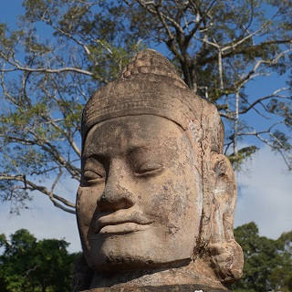 One of the 54 heads lining the causeway to Bayon