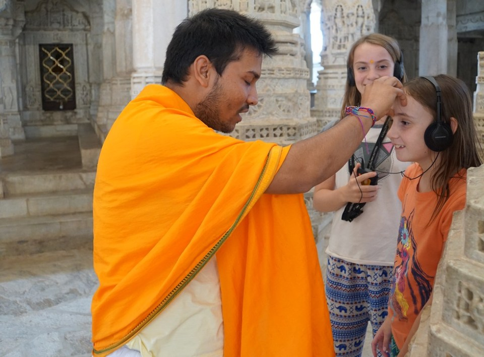 The girls receive a blessing from a Jain monk