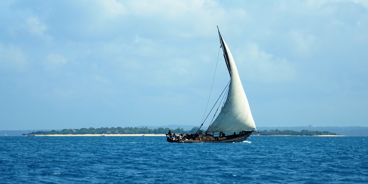 A traditional wooden sailing ship known as a dhow