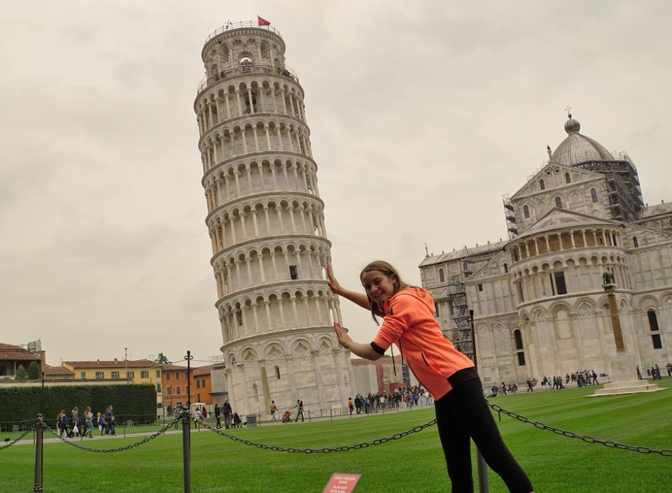 Sophie tries to push over the Leaning Tower of Pisa