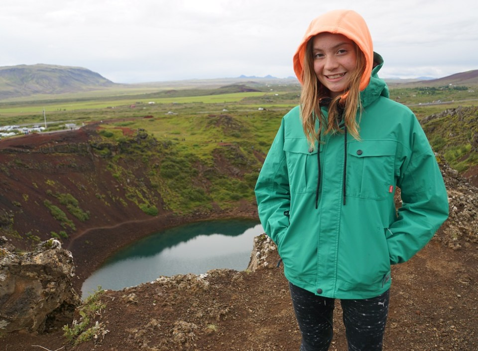 Sophie stands on the rim of the Kerio Crater