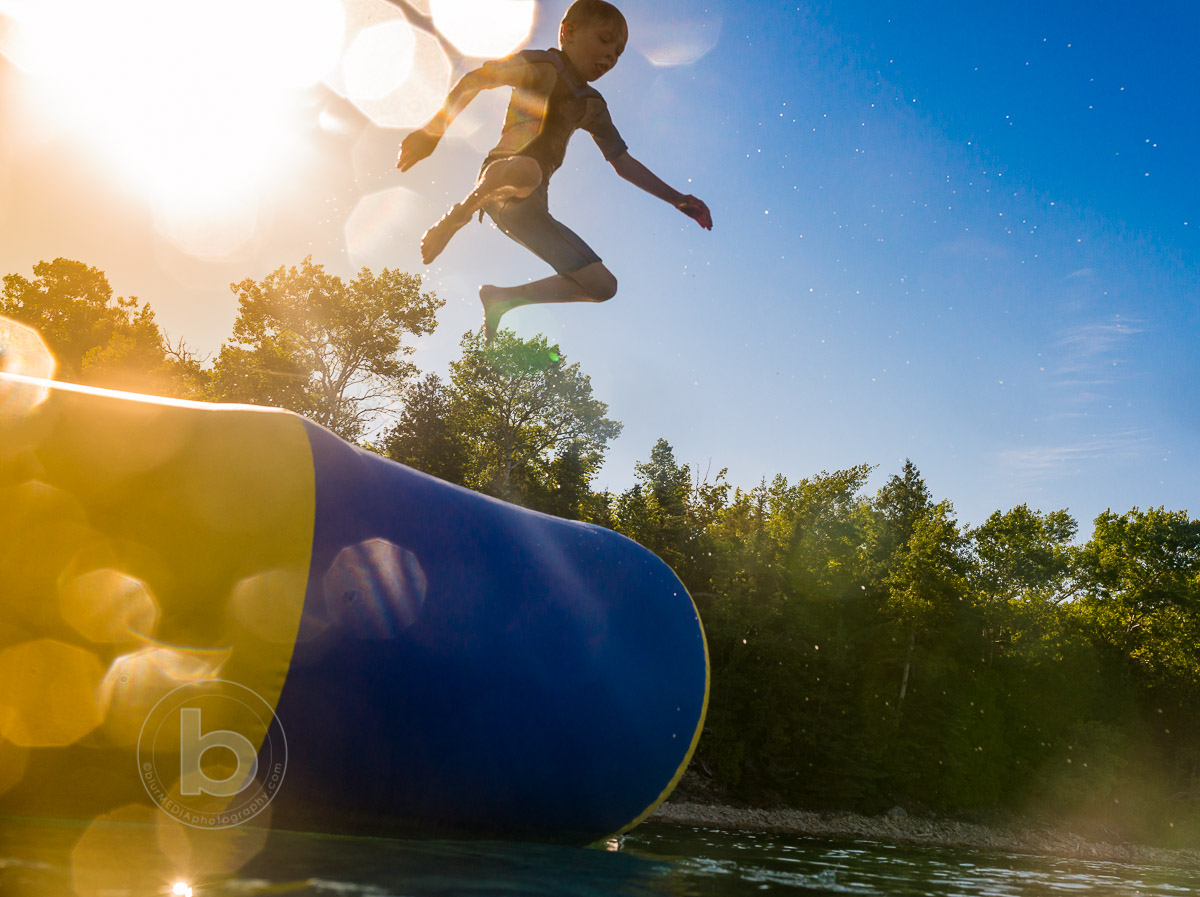 Boy_Jumping_Into_Lake_At_Summer_Cottage