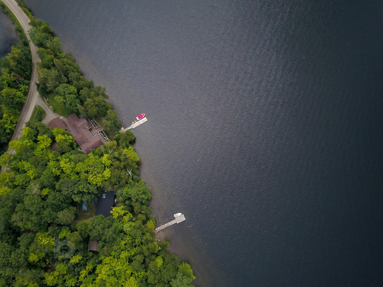 Aerial photo of a lake in the Kawartha cottage region near Haliburton, Ontario, Canada