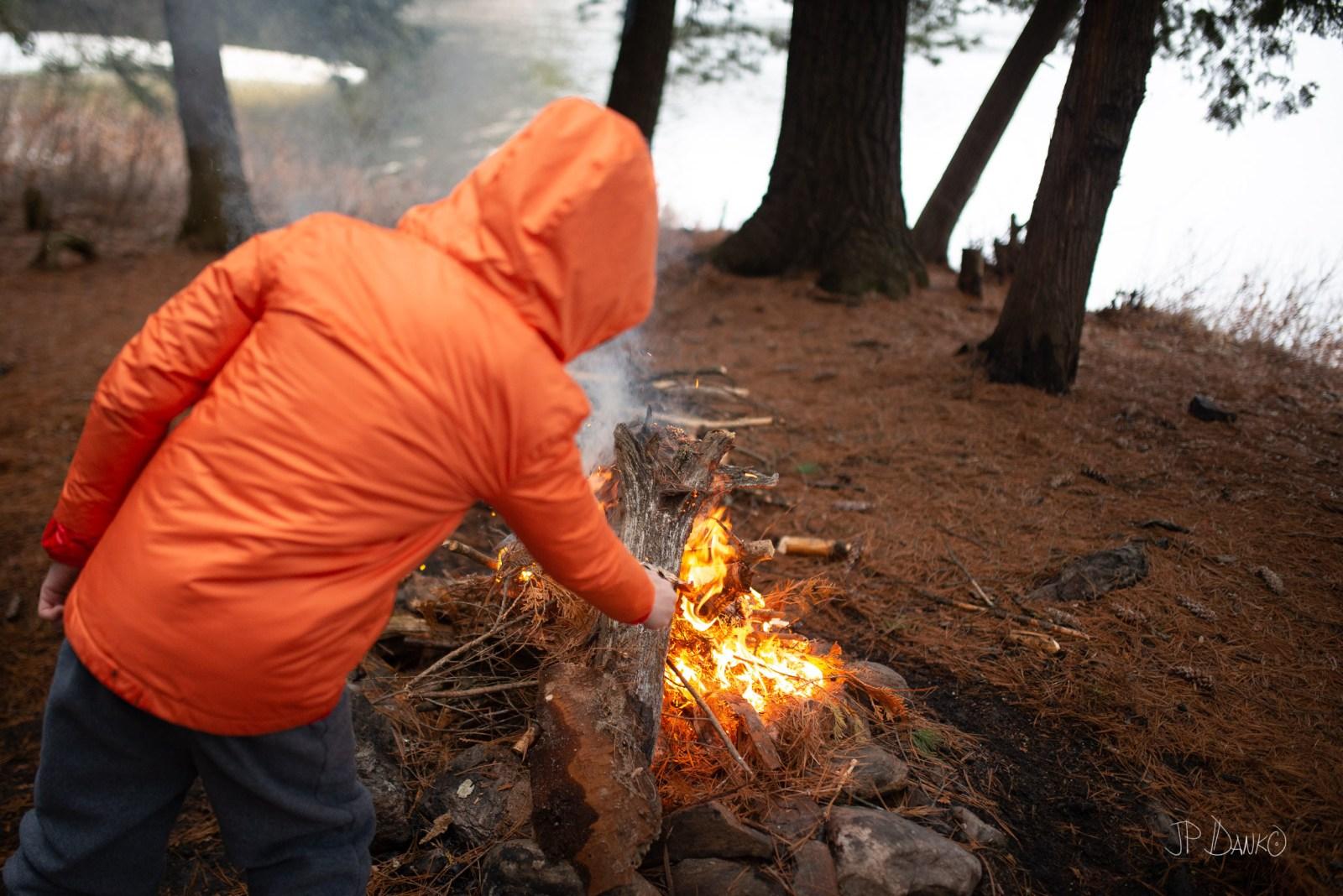 Boy Campfire Spring Canoe Trip Backcountry Wilderness Camping