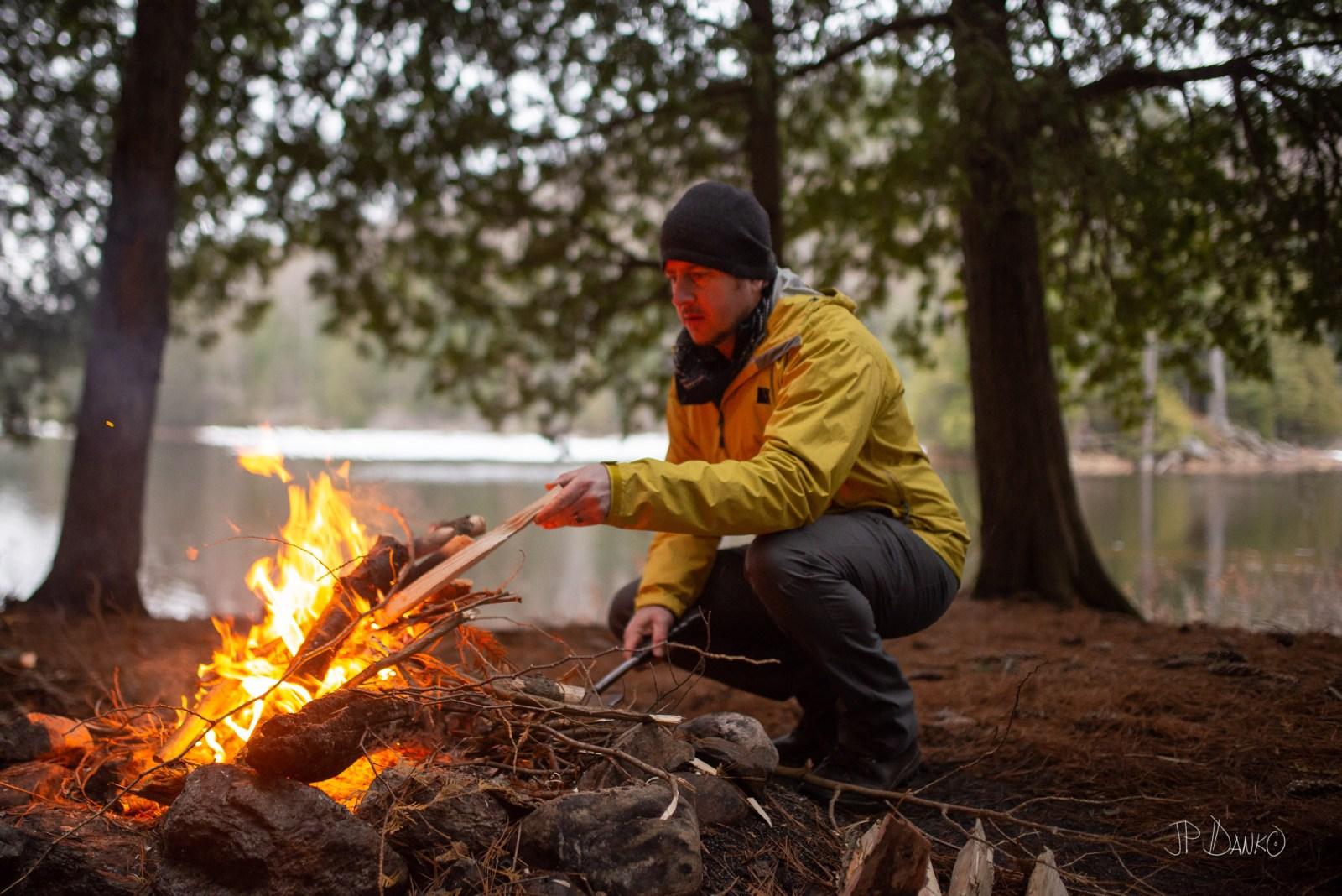 Man Campfire Spring Canoe Trip Backcountry Wilderness Camping