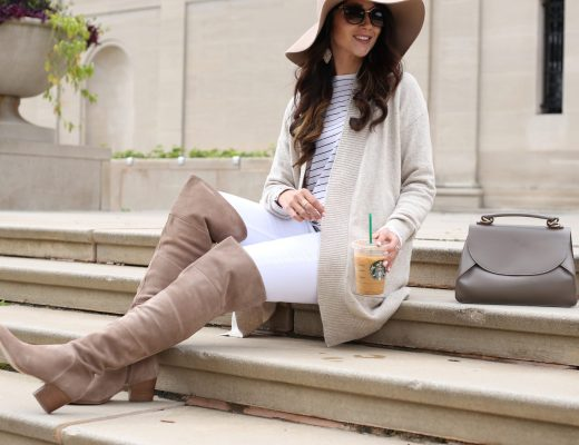blogger Anna Monteiro of Blushing ROse Style wearing cozy fall sweaters and over the knee boots with white jeans and floppy hat in cute fall outfit