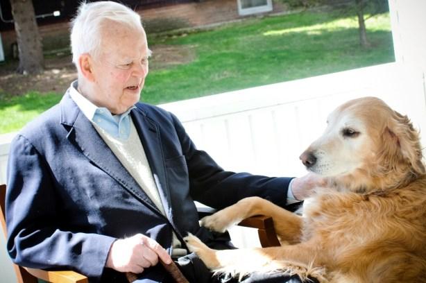 Senator Gannett relaxing with his beloved dog Toby