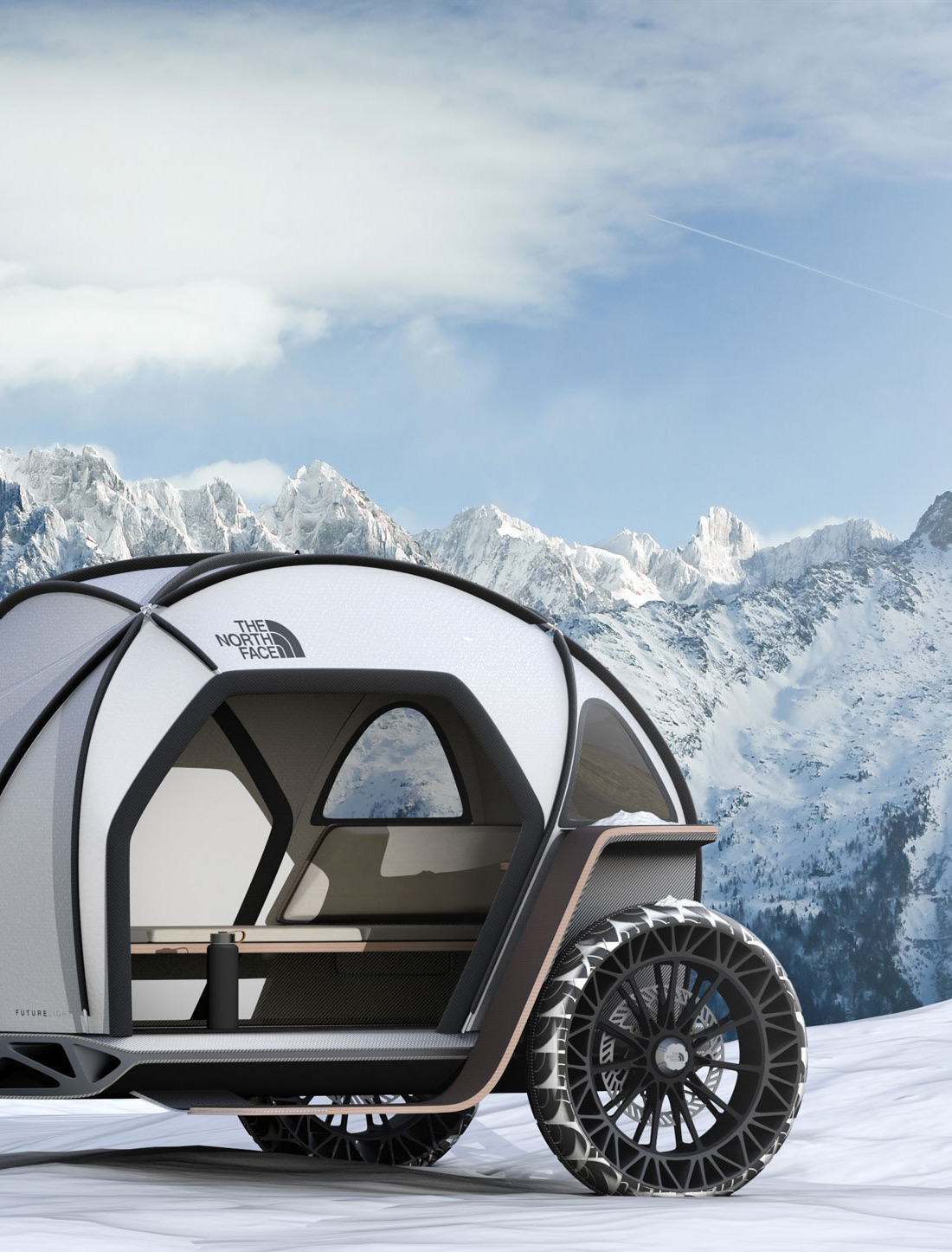 north face camper in the snowy mountains