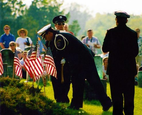 Officers planting flags