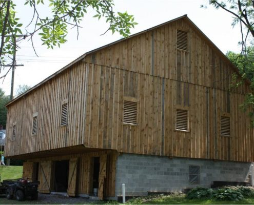 Side view of wooden barn