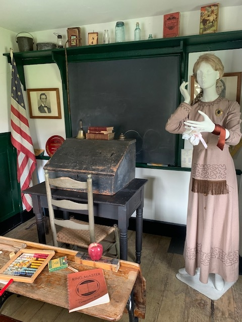 Picture of a teacher and teacher's desk