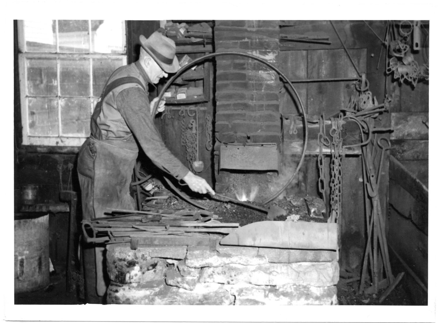 A man does work in his blacksmith shop