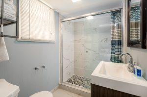 Bathroom of Suite with Full Kitchen at Oceanfront Hotel | Bordwalk Charlee Hotel