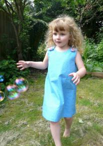 blue pinny Bobbins and buttons
