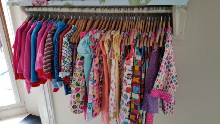 rail of clothes bobbins and buttons