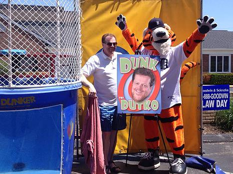 "Bob Dutko Getting dunked for charity by ""Paws"", the official mascot of the Detroit Tigers"
