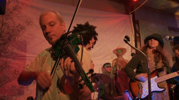 "Phil Heaven aka ""Lucky McLuva"" on 5-string electric viola as Cheri Nunamaker looks on"