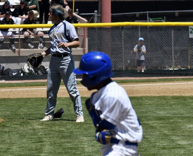 Legacy first baseman Cale Claridge, left, ...