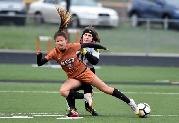 Mead High School's Haley Williams collides ...