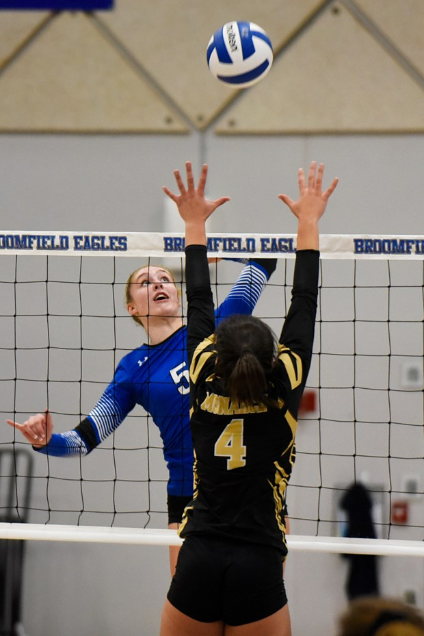 Broomfield's Hope Hanak-Harper, left, tries to ...
