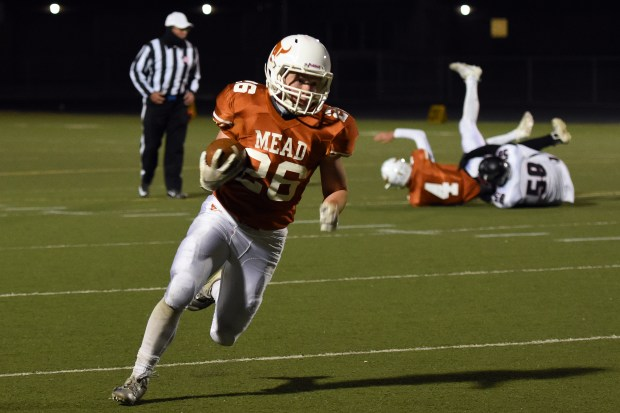 Mead's Nathan Bailey runs for a ...