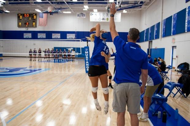 Dawson senior Elizabeth McKean (14) jumps ...