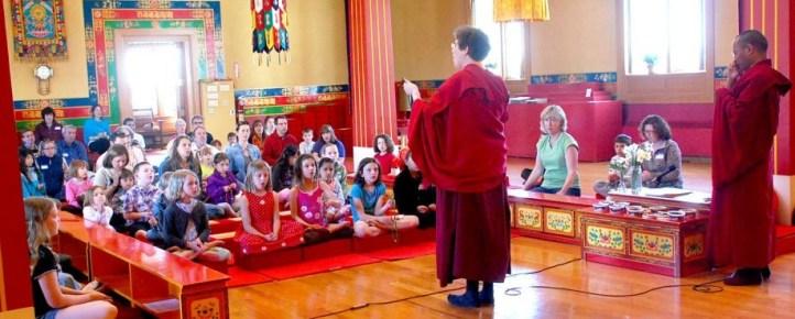 Lama Kathy teaches how to use a mala.