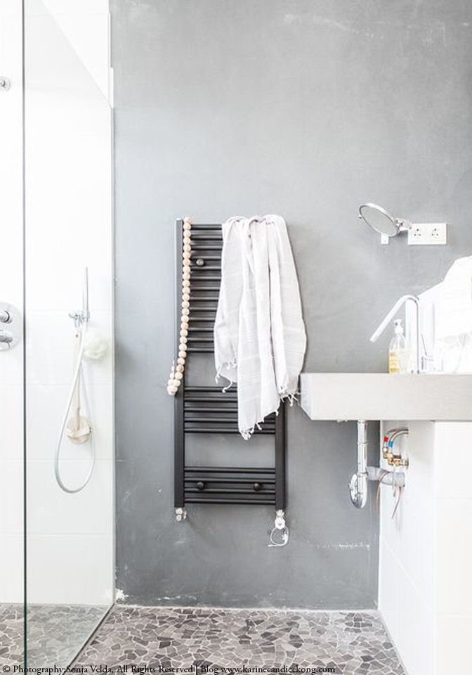 A white, open-plan living dutch family home