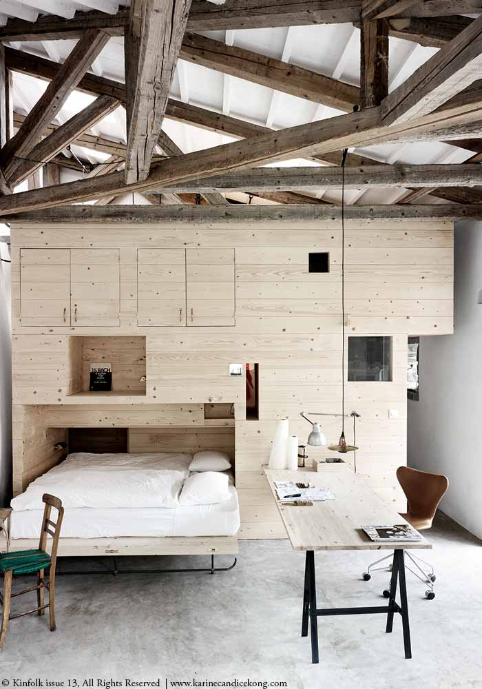A stunning bedroom/workspace with high ceilings & apparent beams