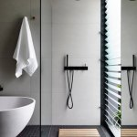 5 Bathrooms with black floor tiles