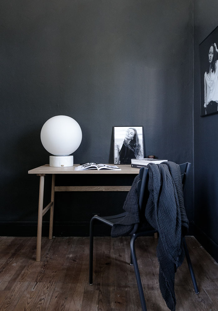 A dark office corner before and after