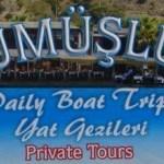 Gumusluk Day Boat Trip sign