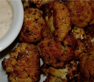 Spicy Cauliflower coated in spices with yogurt dip