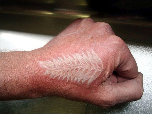 Fern white ink tattoo