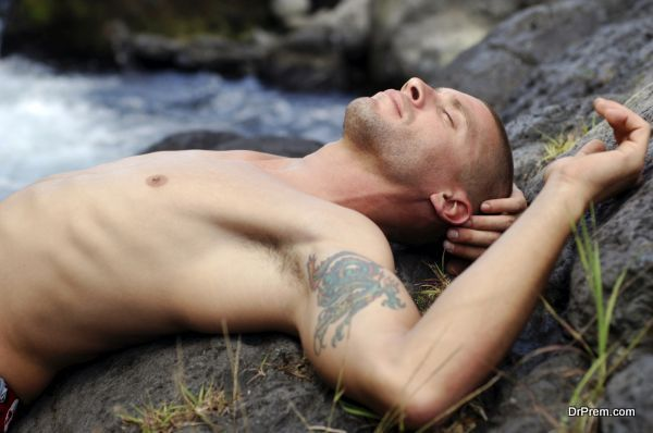 young sexy caucasian man, relaxing near a river