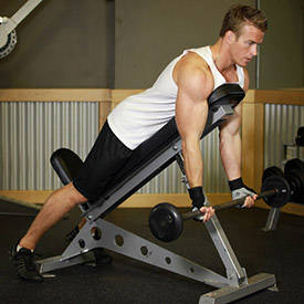 Barbell Curls Lying Against An Incline