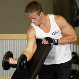 Standing One Arm Dumbbell Curl Over Incline Bench Exercise