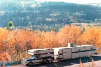 Camper and trailer on the Alcan heading up to Alaska