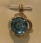 XXXBlue Topaz (13ct.) gemstone pendant with a diamond surround. $725