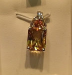 XXXOur photo does not do justice to this beautiful 2.8 ct. Citrine gemstone pendant. Interlocking 18 kt. white and yellow gold setting. $425