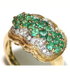 Large 'n jazzy .07ct. Emerald and Diamond cluster ring with a 14kt. yellow gold setting. Size 6. $595