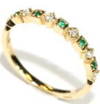 Emeralds and diamonds in alternating square cuts circle this beautiful 14kt. yellow gold ring. Size 7. $479