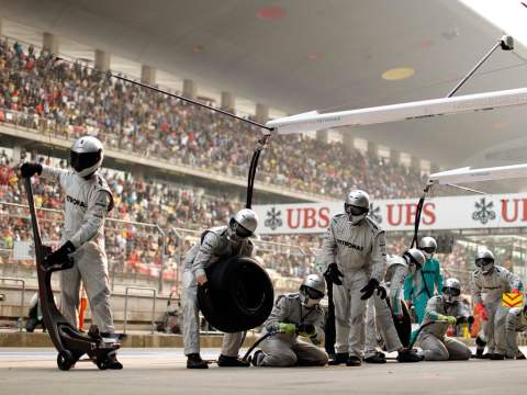 Mercedes pit crew wait poised for the arrival of Lewis Hamilton's car
