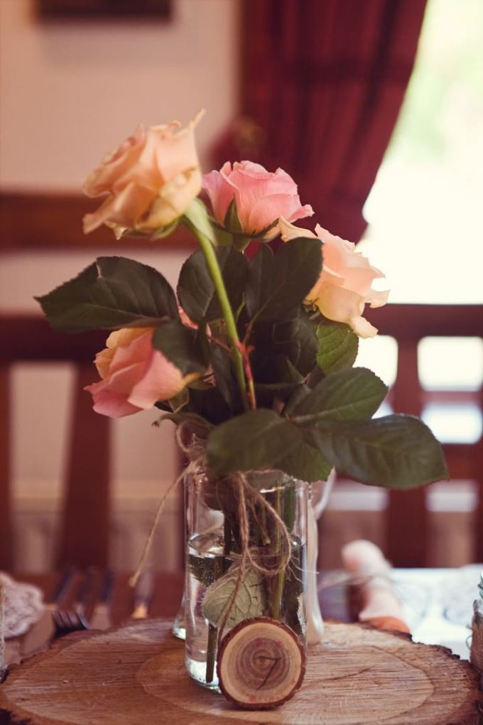 wedding flowers in jam jar