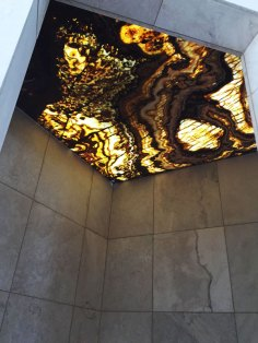 Tiger Onyx Bolder Stone Panel installed as a backlit shower ceiling