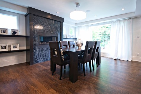 Livingstone Dining room with Ancient Woodgrain Bolder Stone Panel installed on a fireplace