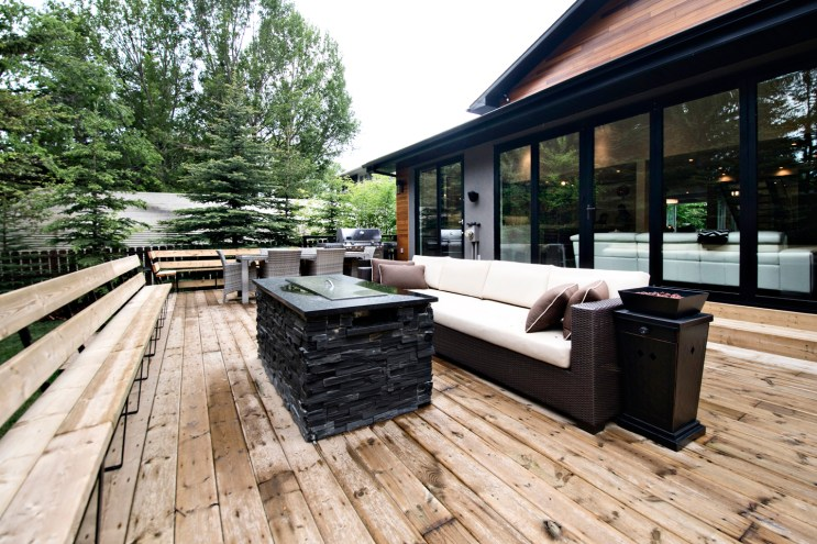 Livingstone back deck completed, including fireplace with jet black slate installed on it