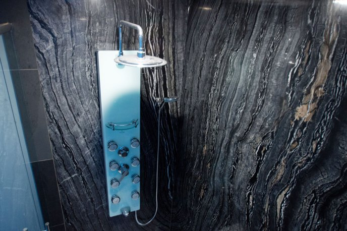 Ancient Woodgrain Bolder Panels installed in a luxurious shower